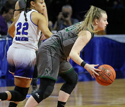 (Brad Davis/The Register-Herald) Wyoming East's Brooke Russell maintains possession under pressure from Fairmont Senior's Courtney Wilfong Saturday afternoon in Charleston.