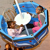(Brad Davis/The Register-Herald) Six-year-olds Selena Ross, left, and Khya Hoskins get a thrill, possibly a slight scare, as they gain speed and altitude being swung in circles aboard the tea cup ride in the carnival area during Chili Night festivities Saturday night in downtown Beckley.