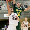 (Brad Davis/The Register-Herald) Woodrow Wilson's Danny Bickey drives and scores as Huntington's Torin Lochow defends Wednesday night at the Beckley-Raleigh County Convention Center.