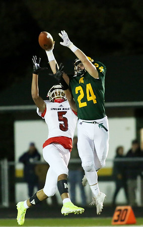 Greenbrier East's Brandon Honaker (24) almost intercepts a pass on third-and-long intended for Spring Mill's Keon Padmore-Johnson (5) during their Class AAA playoff game in Fairlea on Friday. (Chris Jackson/The Register-Herald)