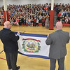 (Brad Davis/The Register-Herald) Young students at Berlin McKinney Elementary School cheer as Delegate Jeff Campbell (D-Greenbrier), left, presents them with an official state flag while Principal Robert Lyons, right, helps him show it Wednesday afternoon in Oceana. Campbell's mother passed away during the last legislative session, and despite having few ties to the area except for being a teacher himself in Greenbrier County, every student at Berlin Mckinney wrote sympathy cards for him. He came back to thank them personally on Wednesday.