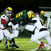 Greenbrier East quarterback Kyle King (15) is tackled by a gang of Spring Mill's players during their Class AAA playoff game in Fairlea on Friday. (Chris Jackson/The Register-Herald)
