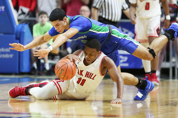 Oak Hill's Jason Manns (11) steals the ball from Robert C. Byrd's Khori Miles (0) <br /> during their West Virginia State Championship Class AA Quarter Finals in Charleston on Thursday. (Chris Jackson/The Register-Herald)