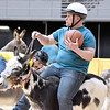 (Brad Davis/The Register-Herald) Billy Pate guides his donkey up the court in the direction of the basket as his team, the Jerusalem Cruisers, take on Buddy's Comancheros during a donkey basketball tournament to benefit the Raleigh County Horseman's Association Sunday afternoon at the Beckley-Raleigh County Convention Center. The rules are simple, as it's basically standard basketball, but you must be on your donkey when taking a shot. You can dismount to pick up a loose ball or move around the court quicker, but you must have your donkey in tow at all times when not riding it. RCHA hopes to have a few more of these events in the future.
