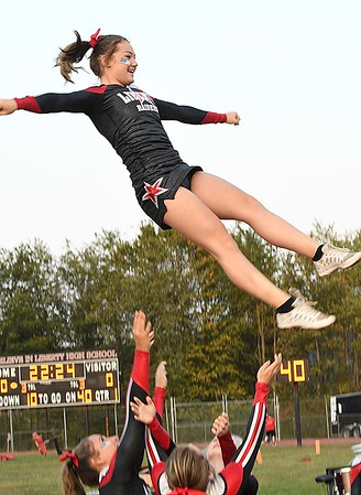 Liberty High School cheerleader Chelsea Jones, gets tossed in the air during game against Pikeview at Liberty High School in Glen Daniels.<br /> (Rick Barbero/The Register-Herald)