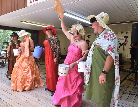 """(Brad Davis/The Register-Herald) Eventual contest winner Chris Repka (2nd from right), stage name """"Sweet Louise,"""" raises his hat to acknowledge the roaring crowd during the Miss Lilly Pageant fundraising event Saturday. All contestants combined to raise $400, which will go towards covering expenses for next year's gathering."""