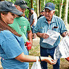 (Brad Davis/The Register-Herald) Hinton residents Samantha Cook and M.J. McBride take a look back in time with Steve Lilly, right, during the 90th annual Lilly reunion Saturday.