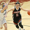 (Brad Davis/The Register-Herald) Summers County's Taylor Issac drives up the court as Spring Valley's Emma Sowards defends during Big Atlantic Classic action Friday afternoon at the Beckley-Raleigh County Convention Center.