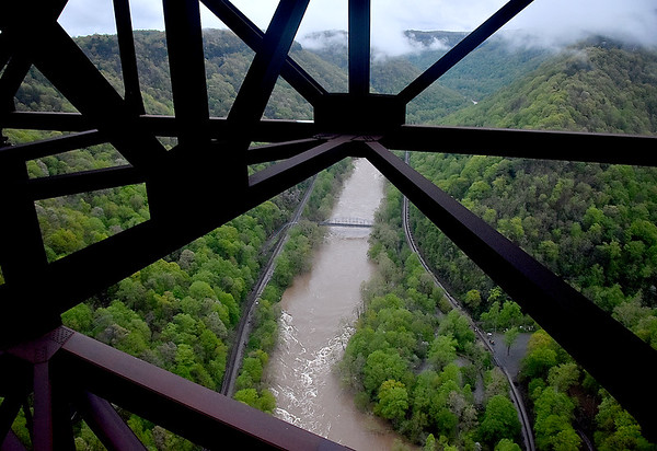 (Brad Davis/The Register-Herald) The scene from the catwalk as the sun rises behind overcast skies during an Easter Sunday New River Gorge Bridge Walk yesterday morning.