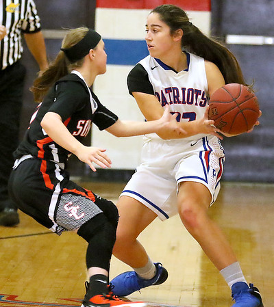 (Brad Davis/The Register-Herald) Midland Trail's Jolee Stephenson works along the perimeter as Summers County's Cheyenne Graham defends Wednesday night in Hico.