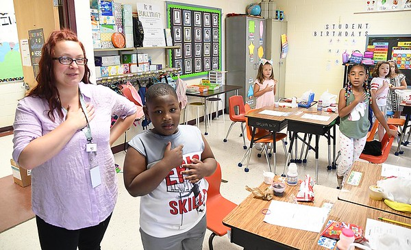 Crescent Elementary School first grade teacher Kayla Boyd and her students say the Pledge of Allegiance to begin their school day.<br /> (Rick Barbero/The Register-Herald)