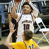 (Brad Davis/The Register-Herald) Woodrow Wilson's Bryant Jones pulls up for a shot as Logan's Garrett Williamson defends during Friday action at the Little General Battle for the Armory.