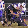 Midland Trails Liam Gill is brought down by Greenbrier West's Levi Weikle and Cole McClung during Friday night's game at Greenbrier West High School. (Jenny Harnish/The Register-Herald)