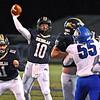 (Brad Davis/The Register-Herald) Nicholas County quarterback Timmy Baker throws a first quarter touchdown in the redzone against Princeton Friday night in Summersville.