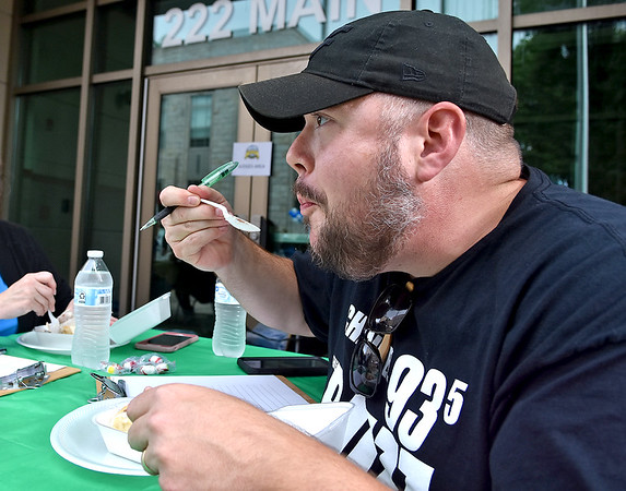 (Brad Davis/The Register-Herald) Food judge Tom Riser enjoys the fare during the Appalachian Fest Block Party August 24 in Beckley.