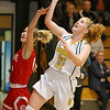 (Brad Davis/The Register-Herald) Greenbrier East's Kate Perkins drives and scores as Hurricane's Taylor Maddox defends Saturday night in Fairlea.