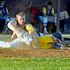 (Brad Davis/The Register-Herald) Summersville Post 131's Nate Hanshew scores a run, beating Beckley Post 32 pitcher Noel Sizemore's tag during a Legion game June 27 at Woodrow Wilson High School.