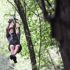 Tom Irin, of England, zips through the woods on the Canopy Tour during the World Scout Jamboree held at the Summit Bechtel Reserve in Glen Jean.