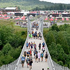 (Brad Davis/The Register-Herald) Scouts make their way to and from a basecamp area via the Consol Energy Bridge during the last day of World Scout Jamboree activities Thursday afternoon at the Summit Bechtel Reserve.
