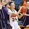 (Brad Davis/The Register-Herald) Summers County's Gavin Pivont works into the paint as River View's Jenna Atwell defends Saturday night in Hinton.