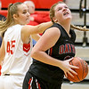 (Brad Davis/The Register-Herald) Oak Hill's Savannah Holbrook takes a pass in the paint and turns to the basket as Greater Beckley Christian's Allie Smith defends Friday night in Prosperity.