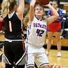 (Brad Davis/The Register-Herald) Midland Trail's Emily Dickerson drives to the basket as Summers County's Bethani Cline defends Wednesday night in Hico.