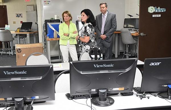 WV HIVE director Judy Moore, gave a tour to, Senator Shelly Moore Capito, left and ARC Co-Chair Tim Thomas, of the HIVE network, an entrepreneurial support network serving locations in Beckley, Summersville, Lewisburg, and Hinton.<br /> (Rick Barbero/The Register-Herald)