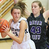(Brad Davis/The Register-Herald) Shady Spring's #13 works underneath as Riverview's Emily Auville defends Friday night in Hinton.