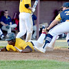 (Brad Davis/The Register-Herald) Beckley Post 32's Ty Nelson dives and scores a run on a wild pitch before Summersville Post 131 infielder Jak Kuhl can tag him Thursday evening at Woodrow Wilson High School.