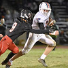 (Brad Davis/The Register-Herald) Independence's Atticus Goodson carries the ball as Liberty's John Tabor moves in for the tackle Friday night in Glen Daniel.