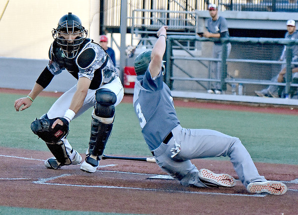 (Brad Davis/The Register-Herald) Miners catcher Kyle Schaefer narrowly misses completing a rare triple-play as Danville baserunner Walker McCleney beats the tag to score from 3rd as the Miner infield turned a 4-6-3 double play Saturday night at Linda K. Epling Stadium.