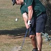 Ethan Bradford, of Wyoming East, gets dirt instead of a divot after hitting his ball because of dry conditions on the par 4, 5th hole during the Class AA Region 3 championships held on Grandview Country Club Monday morning.<br /> (Rick Barbero/The Register-Herald)