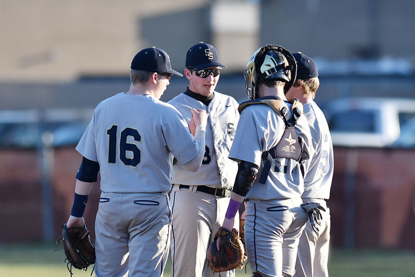 Shady Spring's in-field meets before the start of an inning during their baseball game against Woodrow Wilson in Beckley. (Chris Jackson/The Register-Herald)