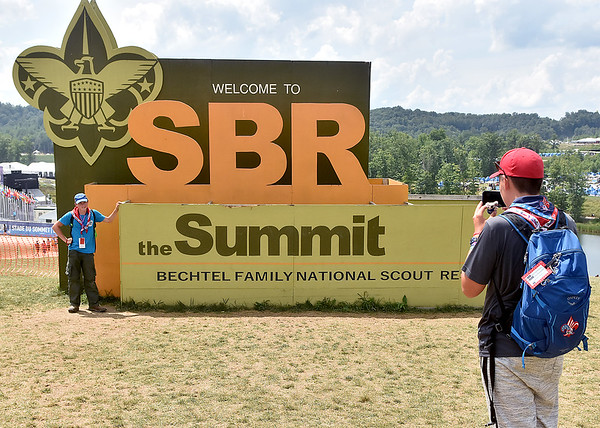 (Brad Davis/The Register-Herald) American scout Luke Williams, left, gets a helping hand with a photo from fellow Amercian Noah Massey during the last day of World Scout Jamboree activities Thursday afternoon at the Summit Bechtel Reserve.