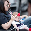 Danielle Scarlett, from Brenton, shields her daughter, Aubree,5-months, during the Labor Day Parade in Pineville on Monday. (Chris Jackson/The Register-Herald)
