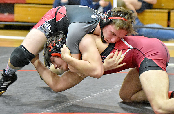 (Brad Davis/The Register-Herald) Liberty's Billy Stoots takes on Oak Hill's Sam Evans in a 160-pound weight class matchup during the Coalfield Conference Invitational Friday night in Oak Hill. Liberty's Stoots won the match.