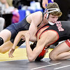 (Brad Davis/The Register-Herald) Shady Spring's Josh Goode takes on Point Pleasant's Christopher Smith in a 126-pound weight class matchup Friday night at the 73rd Annual State Wrestling Tournament in Huntington.