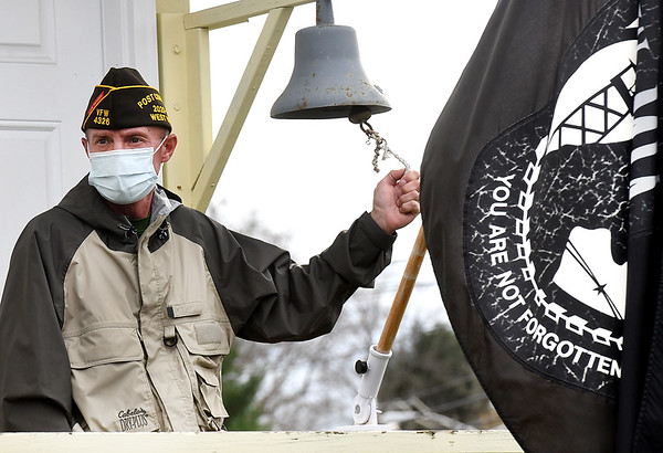 Kevin Meadows, Sophia 4326 VFW commander, rings the bell for deceased veterans  during the Raleigh County Veterans Museum 7th annual Healing Fields Ceremony held at the museum off of Harper Road in Beckley Wednesday afternoon.<br /> (Rick Barbero/The Register-Herald)
