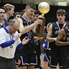 (Brad Davis/The Register-Herald) Princeton's Ethan Parsons and teammates look over the trophy after defeating Huntington for class AAA Boys Championship during the final day of Big Atlantic Classic action Saturday at the Beckley-Raleigh County Convention Center.