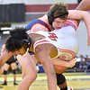 (Brad Davis/The Register-Herald) Midland Trail's Colten Yoder takes on Oak Hill's Dominique Johnson in a 182-pound weight class matchup Friday night at the 73rd Annual State Wrestling Tournament in Huntington. Trail's Yoder won the match after Johnson suffered a knee injury.