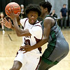 (Brad Davis/The Register-Herald) Woodrow Wilson's Dwayne Richardson drives up the court as Hampshire's Mikhi Anderson defends during Big Atlantic Classic action Friday at the Beckley-Raleigh County Convention Center.