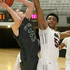 (Brad Davis/The Register-Herald) Wyoming East's Tanner Whitten drives to the basket as Bluefield's Sean Martin defends during the final day of Big Atlantic Classic action Saturday at the Beckley-Raleigh County Convention Center.