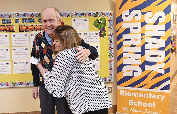 Carl Scrock, left, gets a hug from, Shady Spring Elementary School principal Penny Carrico after Scrock donated $20, 000. to the schools STEM program. He was born and grew up in Gray, Pa. and graduated in mining engineering from Penn State University, and he spent some of his life working in mining industry in West Virginia. He's very passionate about STEM education.<br /> (Rick Barbero/The Register-Herald)