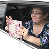 Eve Parks, mother of John Parks, snaps a few pictures of he son receiving his diploma during Greenbrier West High School graduation ceremony Friday evening held at the State Fair of West Virginia's free parking lot in Fairlea. <br /> (Rick Barbero/The Register-Herald)