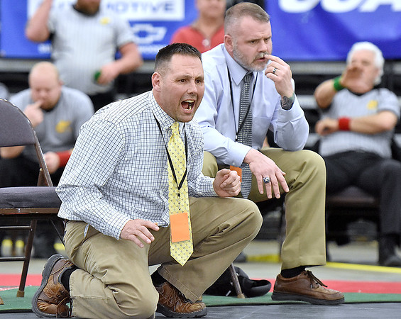 (Brad Davis/The Register-Herald) Greenbrier West coaches Jeremy (near) and Steve Tincher watch and react as their grappler Noah Brown takes on Sissonville's Gavin Shamblin for the 220-pound championship Saturday night at the 73rd Annual State Wrestling Tournament in Huntington. Brown won the match.