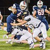 Independence's Isaiah Duncan is upended by Nicholas County's Garrett Kesterson nd Gavin Blankenship converge on the tackle during Friday evening action in Independence. F. Brian Ferguson