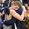 (Brad Davis/The Register-Herald) Nicholas County's Levi Brake gets a big hug from coach after defeating Berkeley Springs' Cole Morris to advance to Saturday's 138-pound weight class final Friday night at the 73rd Annual State Wrestling Tournament in Huntington.