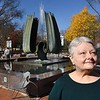 Toni Duncan in front of the Marshall Memorial Fountain in Huntington. She lost brother Gary George to the Marshall Plane crash fifty years ago.<br /> (Rick Barbero/The Register-Herald)