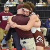 (Brad Davis/The Register-Herald) Woodrow Wilson's Devan Gauldin gets a big hug from coach Matt Osborne after defeating Ripley's Austin Boggess to advance to Saturday's 195-pound weight class finals Friday night at the 73rd Annual State Wrestling Tournament in Huntington.
