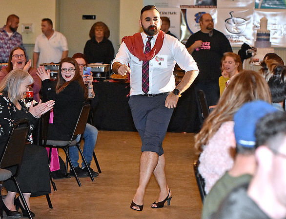 """(Brad Davis/The Register-Herald) Omar Khan owns his walk-on during the opening moments of the Hunks in Heels """"Fur"""" Real fundraising event Friday night at the Beckley Moose Lodge."""